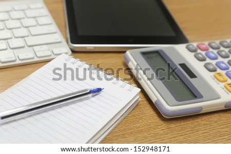 office supplies on a wooden table