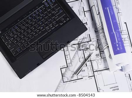 Office supplies on blueprint - stock photo