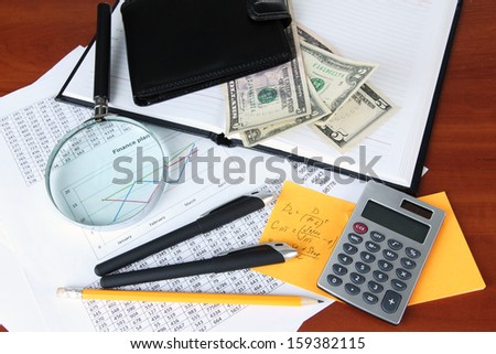 Office supplies with wallet and documents close up