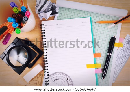 Office table desk with set of Office Stationery, Math Supplies or Science Supplies.. - stock photo
