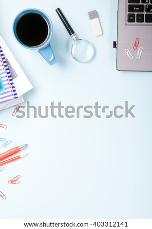 Office table desk with supplies, notepad, computer and coffee cup. Business creative concept. Copy space for ad text - stock photo
