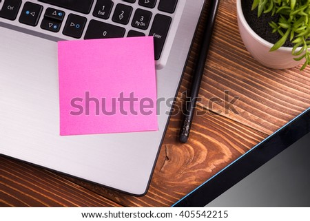 Office table desk with supplies, notepad, computer. Reminder sticky notes on wooden background. Business creative concept. Copy space. - stock photo