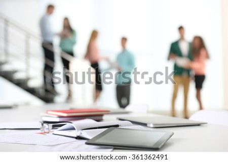 Office table in a conference room on blurred background - stock photo