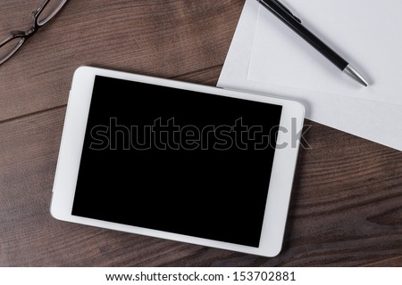 office table of businessman with tablet computer