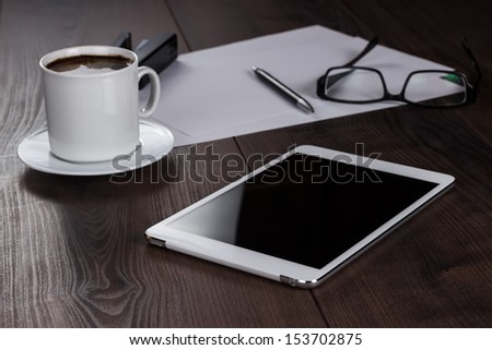 office table of businessman with tablet computer and coffee - stock photo