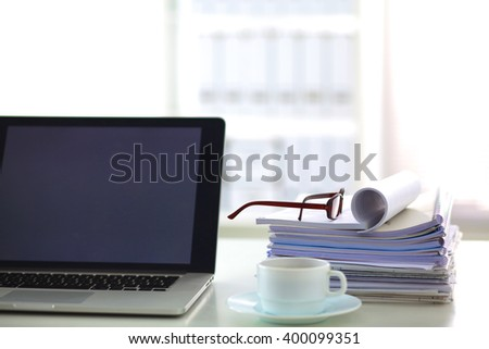 Office table with blank notepad and laptop  - stock photo