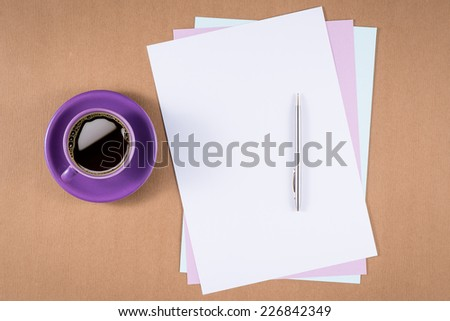 Office table with blank paper, pen and coffee cup. View from above with copy space. - stock photo