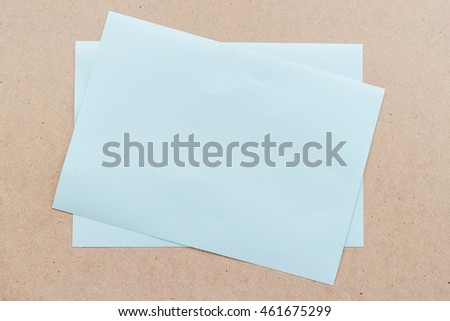 Office table with blue paper sheet, top view