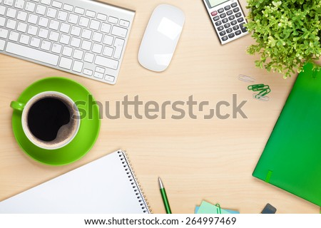 Office table with coffee cup, computer and flower. View from above with copy space - stock photo