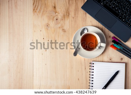 Office table with coffee cup, computer. View from above with copy space