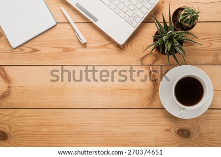 Office table with cup of coffee   - stock photo