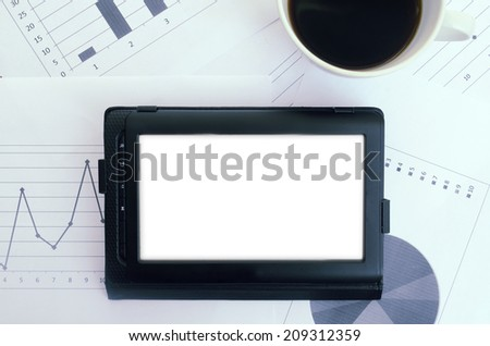 office table with electronic devices and blank sheet of paper