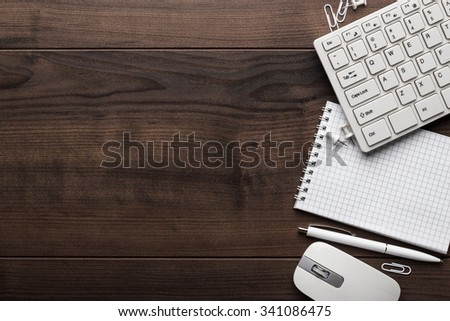 office table with notebook, computer keyboard and mouse - stock photo