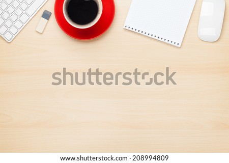Office table with notepad, computer and coffee cup. View from above with copy space - stock photo