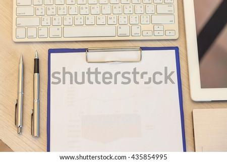 Office table with notepad, tablet, computer and pen, pencil. View from above with copy space - stock photo