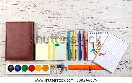 Office  table with notepads, diaries and pens - stock photo