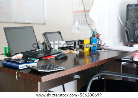 office table with PC and different stationery on it