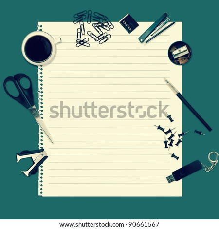 Office table with stationery accessories and empty paper for your text - stock photo