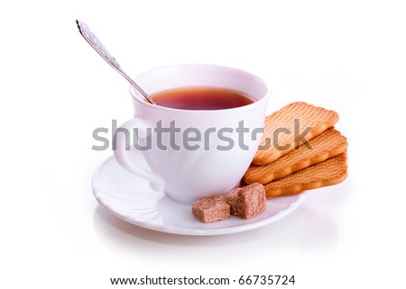 Office tea dial-up a white cup, a saucer, a spoon, cookies and reed sugar isolated on a white background - stock photo