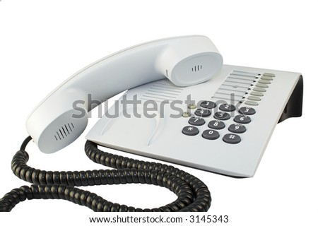 Office telephone with sinuous cord isolated on white.