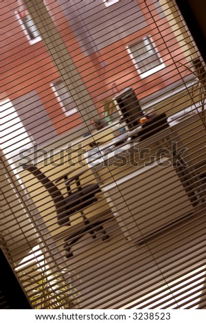 office through the window with sun-blinds