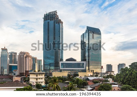 Office towers and shopping mall in construction in Jakarta, the capital city of Indonesia - stock photo