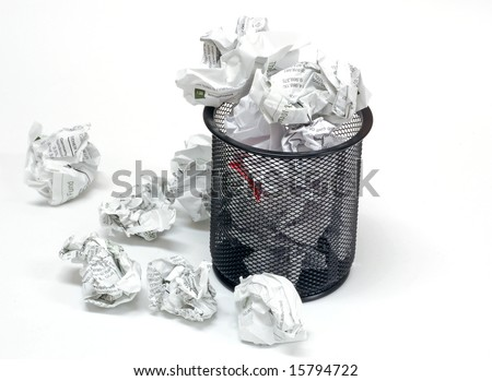 Office wastebasket and paper on a white background - stock photo
