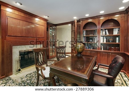 Office with fireplace and cherry wood - stock photo