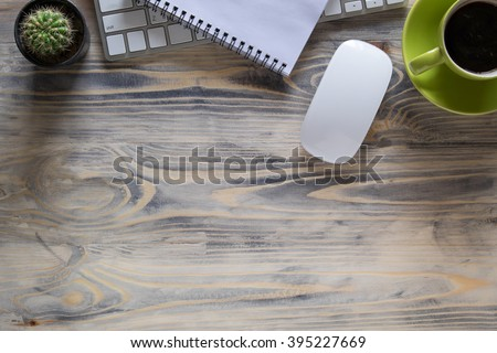 Office wood table with notepad, computer and coffee cup. View from above with copy space - stock photo