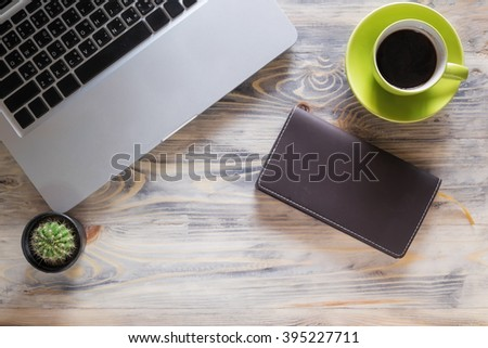 Office wood table with notepad, computer laptop and coffee cup. View from above with copy space - stock photo