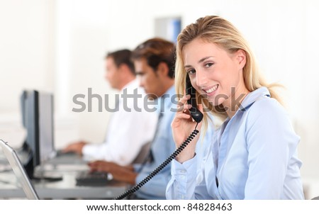 Office worker answering the phone