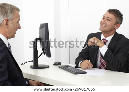 Office worker, consultant, in office with client - stock photo