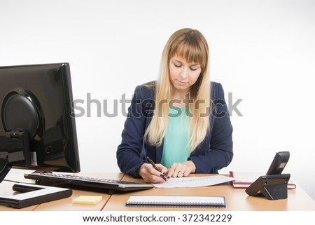 Office worker enthusiastically studying a paper document