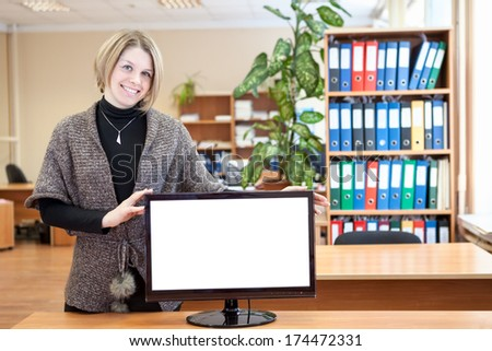 Office worker holding monitor with white isolated screen - stock photo