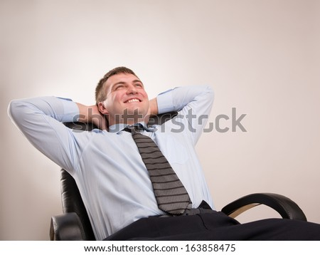 Office worker in a suit celebrates victory - stock photo