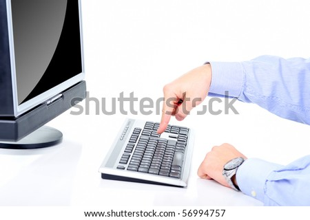 Office worker is pushing the key - stock photo