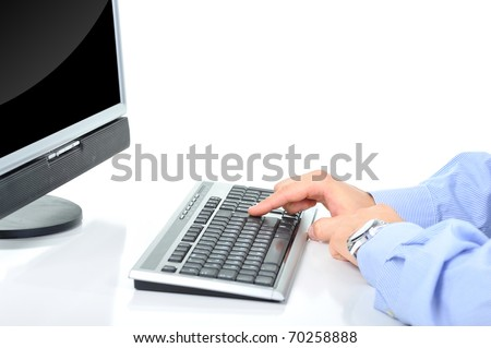 Office worker is typing a document on the desktop - stock photo