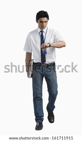 Office worker looking at wristwatch - stock photo