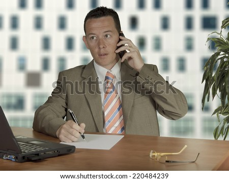 Office worker on phone at office