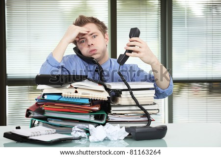 Office worker overworked - stock photo