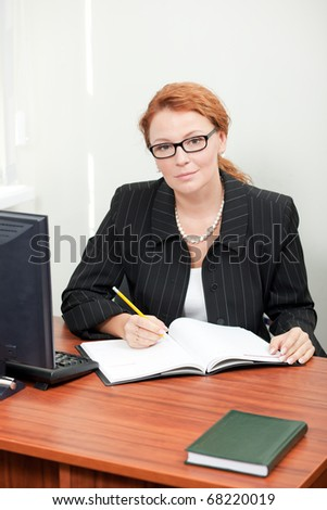 Office worker posing for camera indoor - stock photo