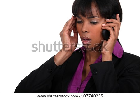 Office worker receiving bad news over the telephone - stock photo