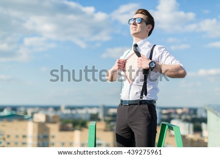 Office worker rests on the roof