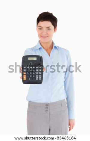 Office worker showing a calculator against a white background