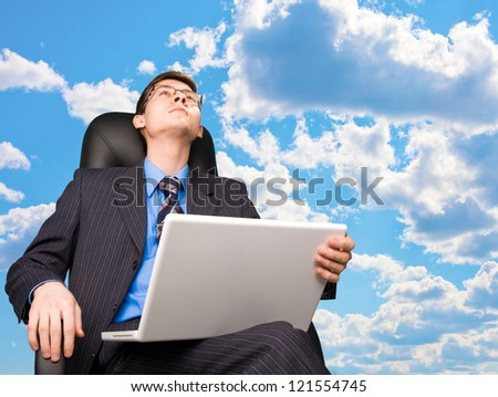 Office worker sitting in office chair at sky background