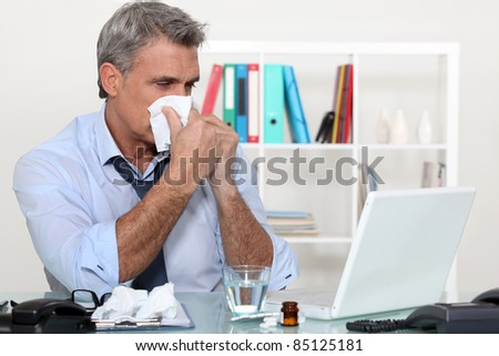 Office worker suffering from a cold - stock photo
