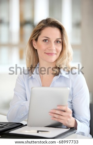 Office worker using electronic tab - stock photo