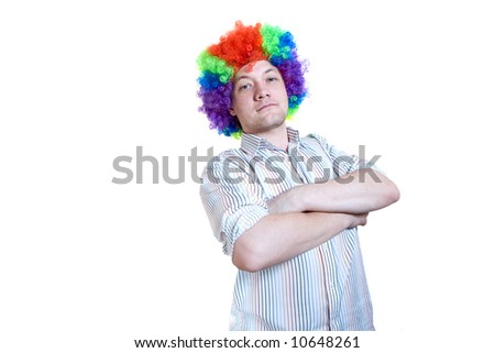 Office worker with clown  wig on a head