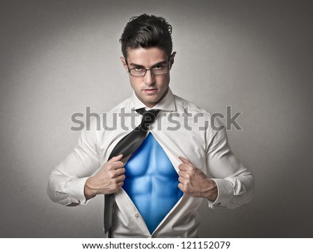 Office worker with glasses opening his shirt like a superhero - stock photo