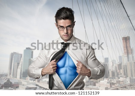 Office worker with glasses opening his shirt like a superhero with the New York skyline in the background - stock photo